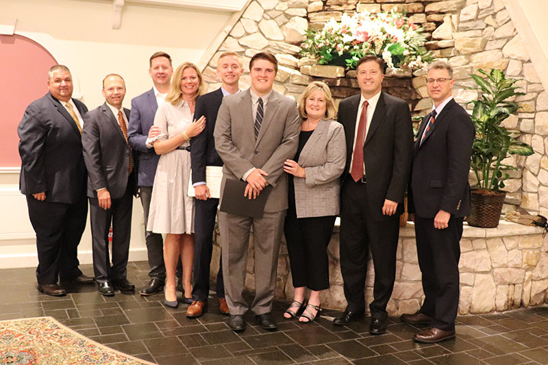 Matthew Jackson and Daniel Rusk from Marlboro are joined by family and school administrators at the May 29 dinner honoring valedictorians and salutatorians throughout the region.