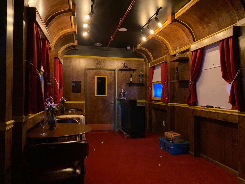 The room for Budapest Express is made to look like a 1930s vintage railroad car passenger car.