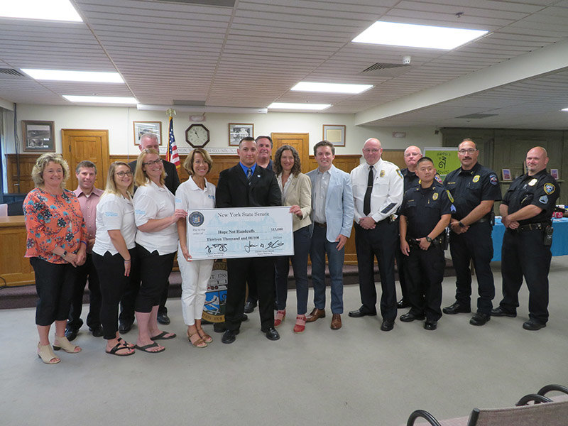 Senators Jen Metzger and James Skoufis presented Hope Not Handcuffs—a police-community partnership which provides access to substance abuse treatment—with a $13,000 grant Tuesday for the program's outreach efforts. Photo by Laura Fitzgerald.