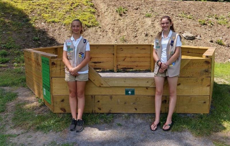 Girl Scouts Alivia Menser and Amanda Robertson stand in front of their gaga ball pit at Cluett Schantz Memorial Park.