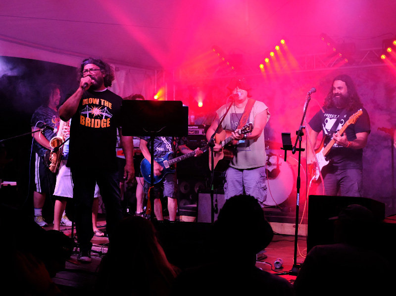 The Mazzstock All Star Band, led by festival founder Big Lee Mazzola, performed on the west stage in the heat of Saturday night.