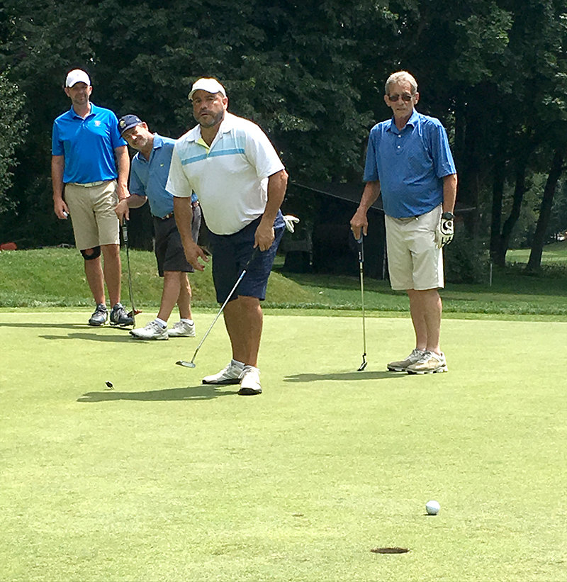 Bill Karnett, Dr. Andrew Resler, Mike Pacella and John Sergi playing in the Kaplan-Larkin Golf Outing at the Powelton Club in Newburgh.