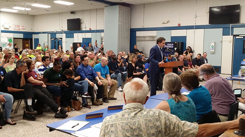 New York State Senator James Skoufis addresses the Town of Montgomery Planning Board during the public hearing on the Medline Warehouse's Draft Environmental Impact Statement held in the Valley Central Middle School cafeteria to a standing room only crowd.