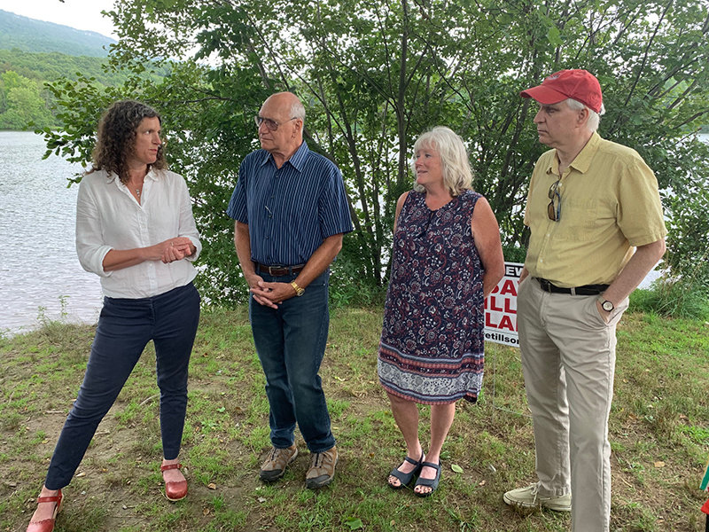 New York State Senator Jen Metzger, Friends of Tillson Lake President Morey Gottesman, Gardiner Town Supervisor Marybeth Majestic and Friends of Tillson Lake Vice President Andy Hague discuss Tillson Lake's future at a press conference on Aug. 14. Photo by Laura Fitzgerald.