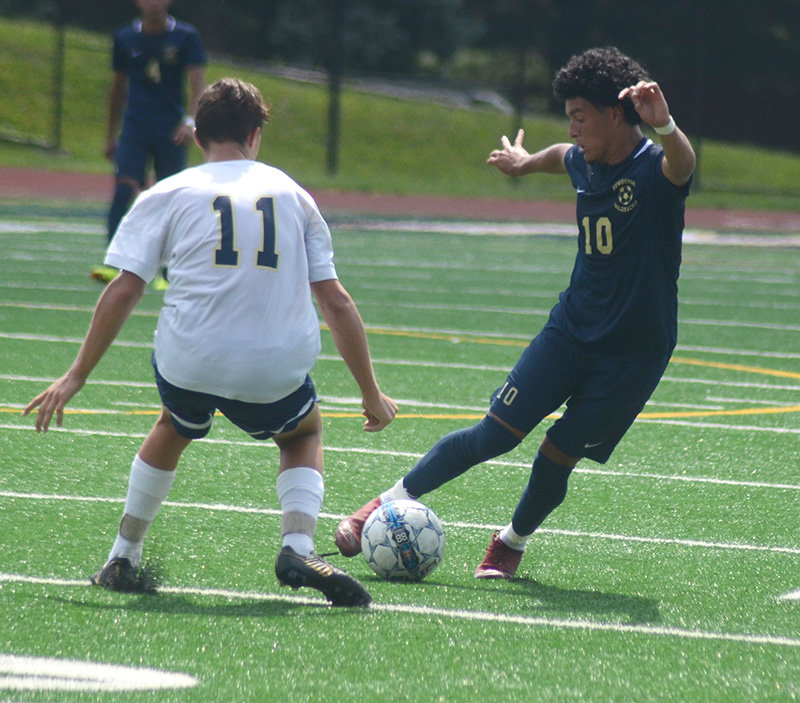 Newburgh's Jesus Martinez pushes the ball past a Beacon player during Thursday's scrimmage at Academy Field.