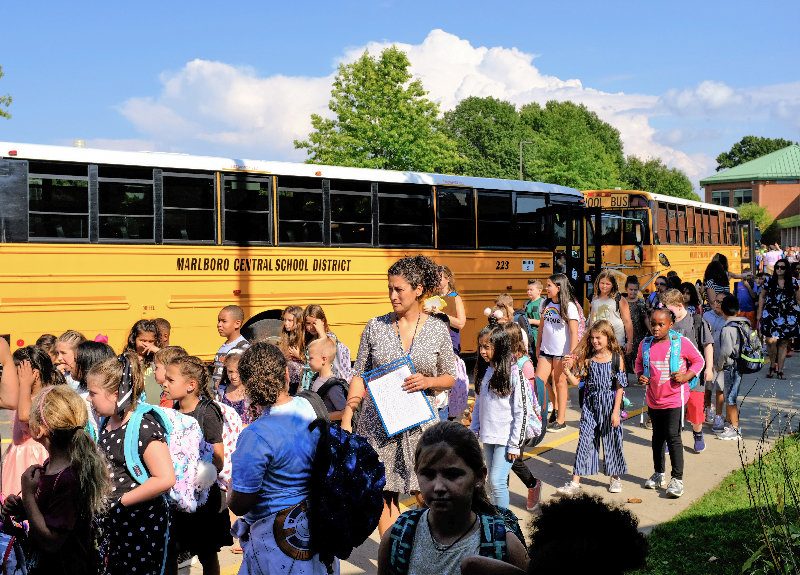 Third Grade teacher Tracey Daley makes sure every student makes it to their bus.