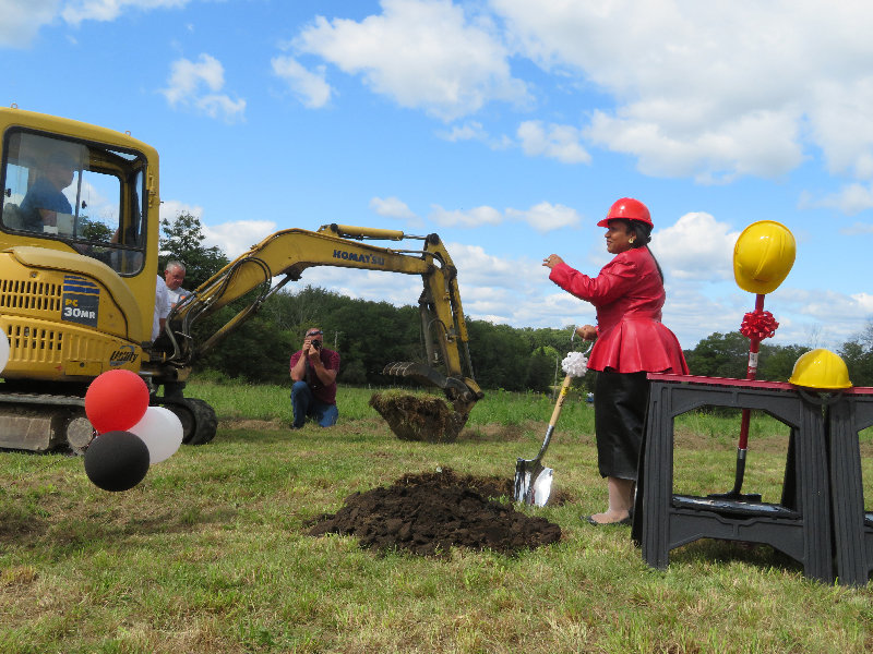 Walden United Methodist Church Pastor Scharlise Dorsey breaks ground on the church's new building at a ground-breaking ceremony on Sept. 7.