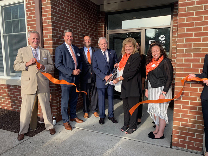 Pictured  (from left): Managing Director of Private Banking Tim McCausland, President and CEO Michael Gilfeather, Senior Vice President Relationship Manager Greg Sousa, Chairman of the Board Lou Heimbach, Assistant Secretary and Branch Manager Lisa Spizuco and Business Banker Tina Santiago unveil the newly remodeled Orange Bank and Trust branch at 2093 New York State Route 208, Montgomery.