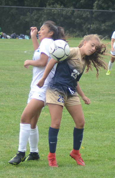 Newburgh's Mikayla Podlas and a Middletown player play the ball during Friday's OCIAA Division I girls' soccer game at NFA North.