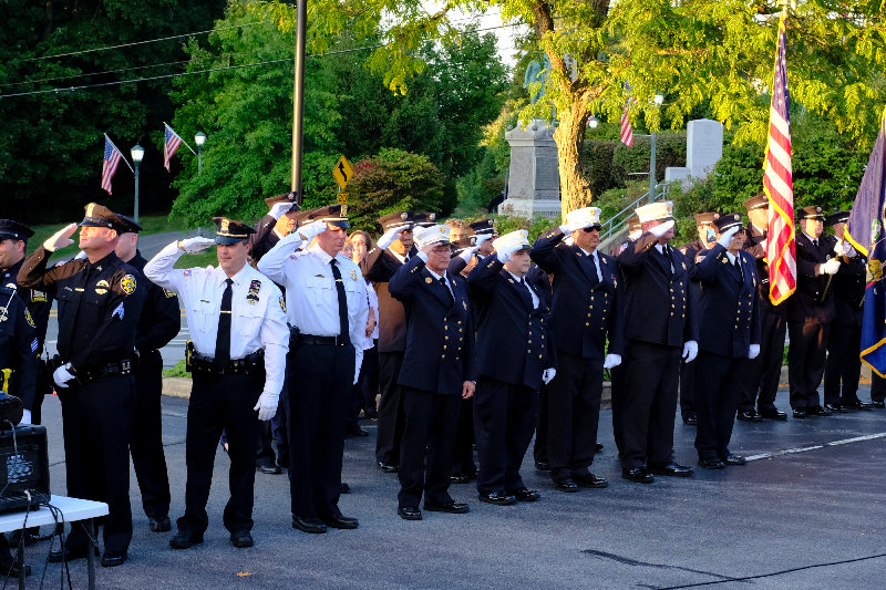 The Lloyd Police and Fire Departments salute during the Pledge of Allegiance.