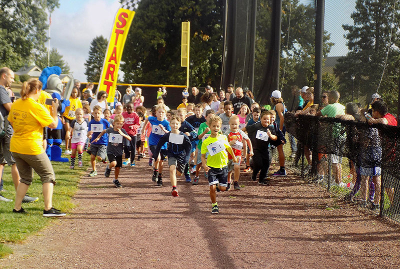 And they're off! The first race of the day at the Bishop Dunn Memorial School's Cupcake 5K Run/Walk on Sunday, September 15 was for the kids.