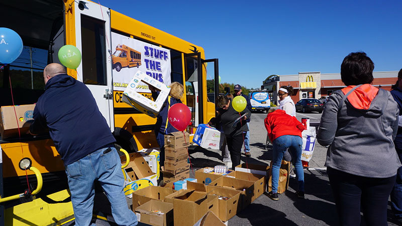 Members of the Highland Support Association and some students volunteered their time to the event to help sort through the food at the Stuff the Bus event on Saturday.