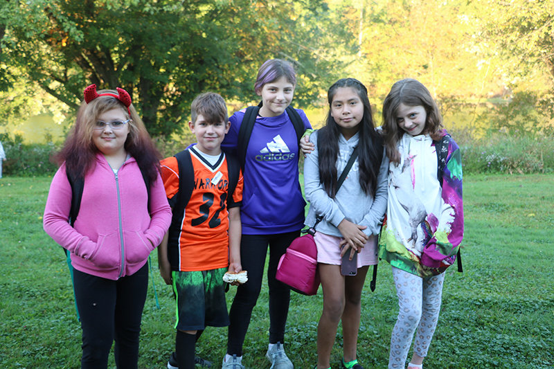 Among the 215 Ostrander Elementary School students participating in National Walk to School Day on October 2 were (from left to right), Genevieve Arlt (Grade 3), Gavin DeGraw (Grade 4), Annalee Maiaro (Grade 6), Helen Bravo (Grade 6), and Shyanne Rahm (Grade 6).
