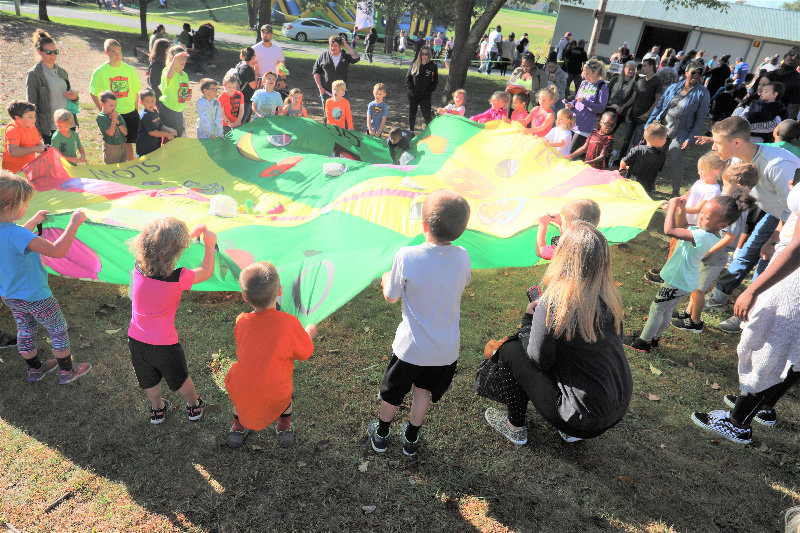 Youngsters participate in parachute activities during the recent Warrior Kids Challenge in Circleville.