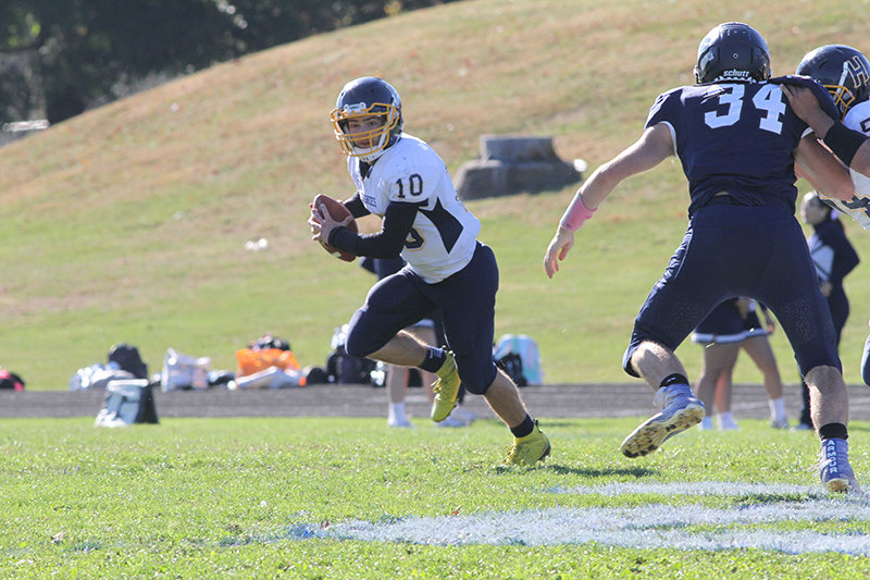 Highland Quarterback Brian Joyce scrambles in the second quarter of Saturday's game at Burke.