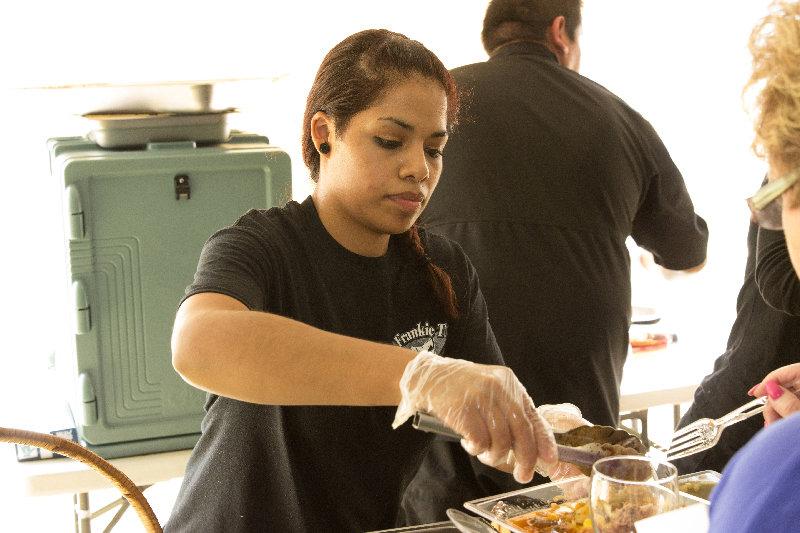 From 2015: Carmen Medina serves boneless brazed short ribs at a Taste of Montgomery.