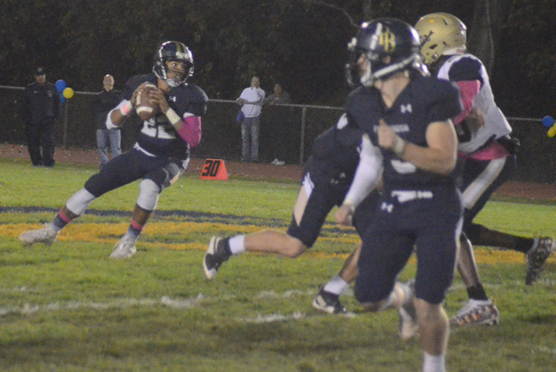Pine Bush's Kenny Holland looks down the field to make a pass as Gunnar Meland runs a route during Friday's Class AA football game at Thomas Lonergan Field in Pine Bush.
