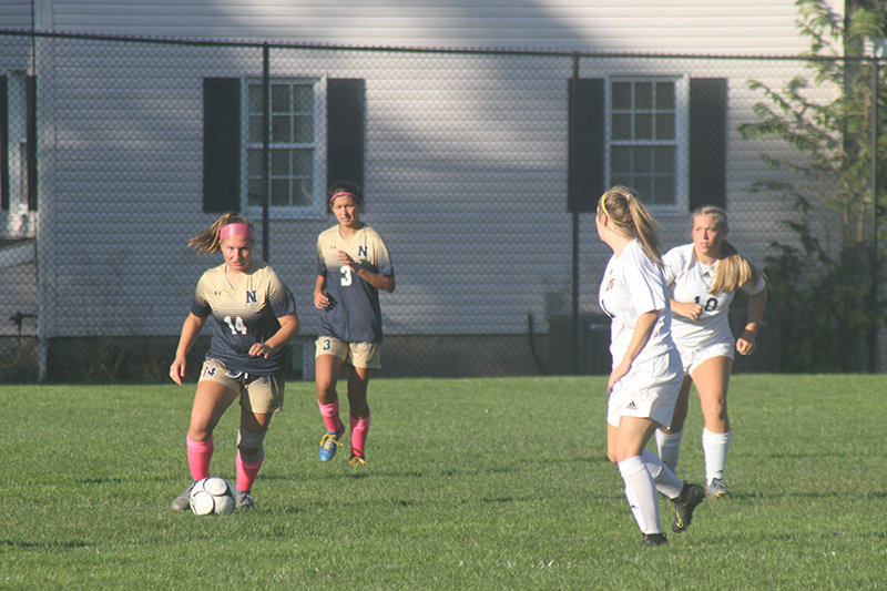 The Lady Goldbacks recorded their fifth win of the season last Thursday, blanking Pine Bush 3-0. Pictured (l - r.) Maddy Noble (14) moved the ball downfield