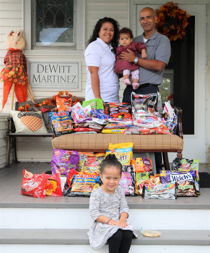 The Martinez family of Pine Bush is collecting Halloween Candy at their funeral home.