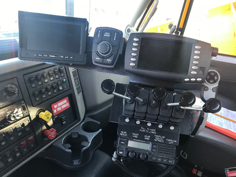 Controls for the brace, tow plow and double wing inside a truck.