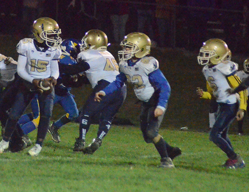 Town of Newburgh quarterback Jaiseon Barnwell prepares to hand the ball off as fullback Austin Lilla (82) leads and Julian Ricks trails during Sunday's Division II OCYFL playoff game against Washingtonville at Lasser Park in Salisbury Mills.