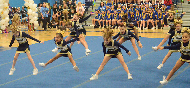 The Town of Newburgh Goldbacks Division I cheerleaders perform at Cheerfest on Saturday at Wallkill High School.