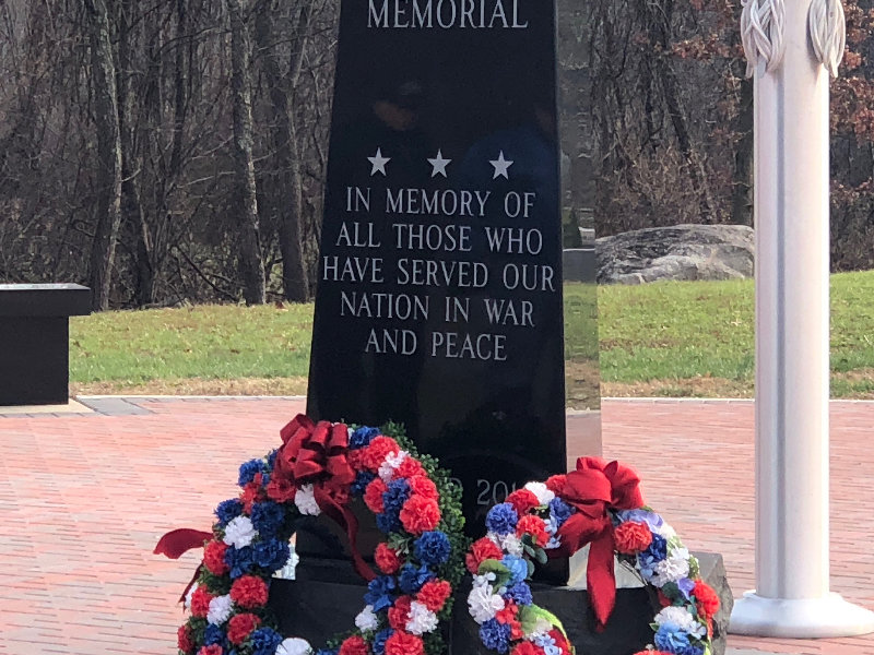 Flower wreaths were placed next to the Veterans Memorial located at Thomas Felten park in honor of all veterans who have served.
