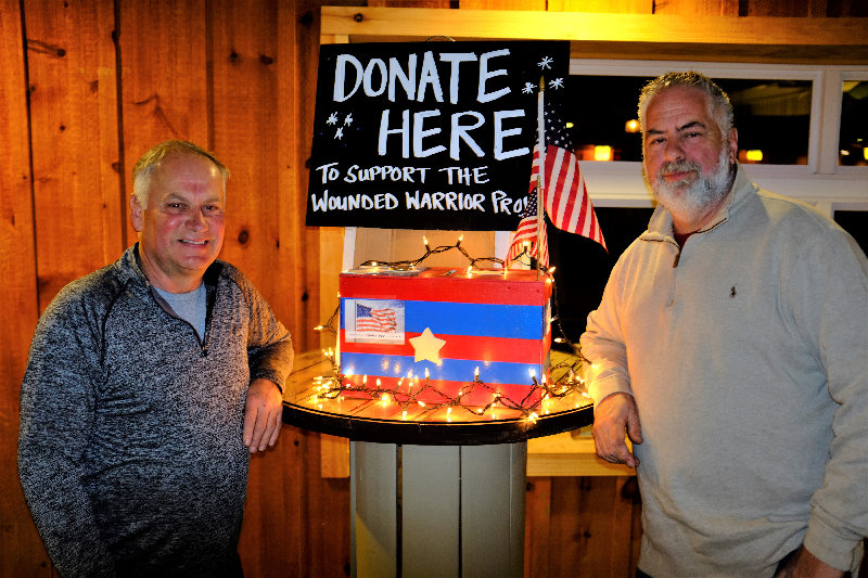 Stephen Adamshick (L) and Dave Pulliam founded the local 'Salute To Veterans, Never Forget What They Did For U.S.' fundraiser for the Wounded Warrior Project at Weed Orchard and Winery in Marlboro.