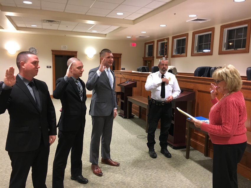 Shawangunk officers Kyle Weiskettle, Justin Larchevesque and John Lembo left to right with Chief of Police Gerald Marlatt and Town Clerk Jane Rascoe administering the oath.