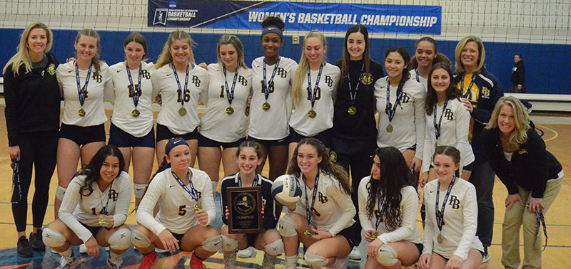 The Pine Bush volleyball team poses after winning the Section 9 Class AA championship with a 3-0 win over Monroe-Woodbury on Sunday at SUNY New Paltz.