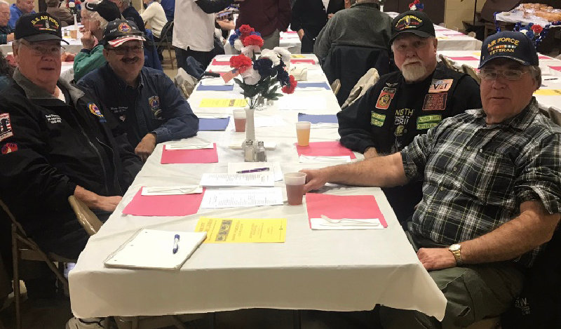 Veterans at the free lunch hosted by the St. Charles Borromeo Knights of Columbus Council. Ricky Sherwood (background, left), Jack Versusky (foreground, left), Bob Lewis (background, right) and Jim Malloy (foreground, right).