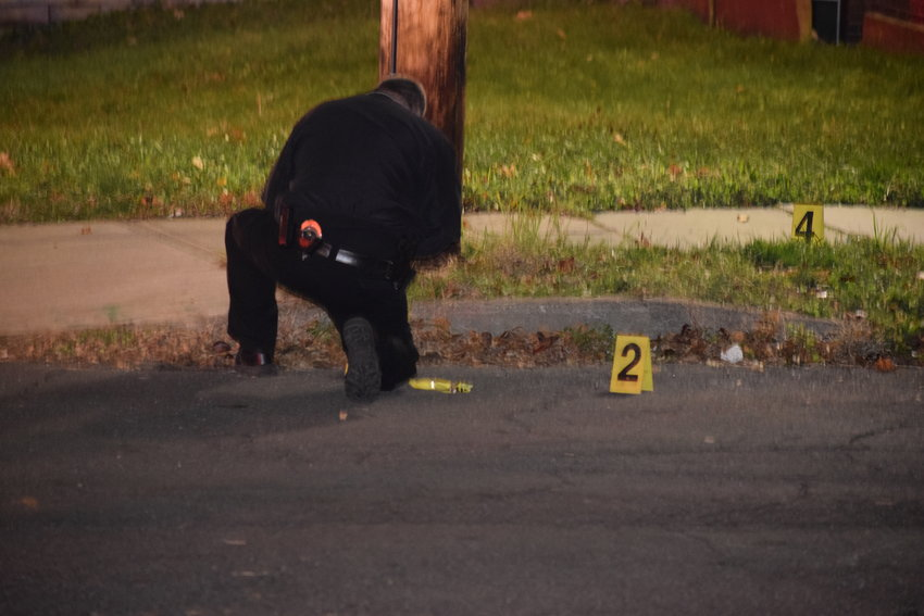 Police leave markers at the scene of a reported shooting, Thursday night