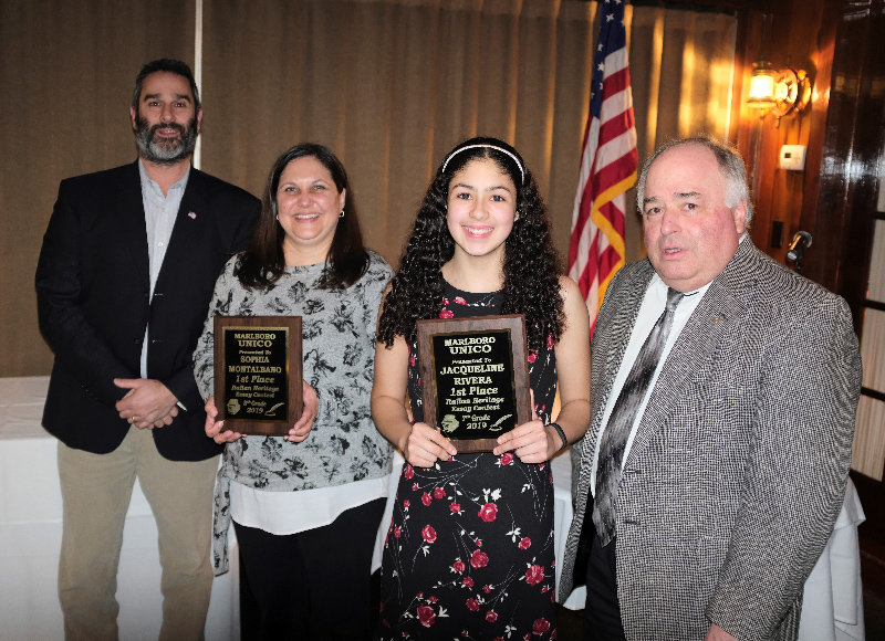 Jacqueline Rivera was the 1st Place winner in the UNICO Essay contest in 7th grade. Pictured L-R Middle School Social Studies teacher Geoff Pesano, Barbara Montalbano, standing in for her daughter Sophia who won 1st Place at the 8th grade level, student Rivera, and UNICO Committee Essay Chair Nick Johannets.