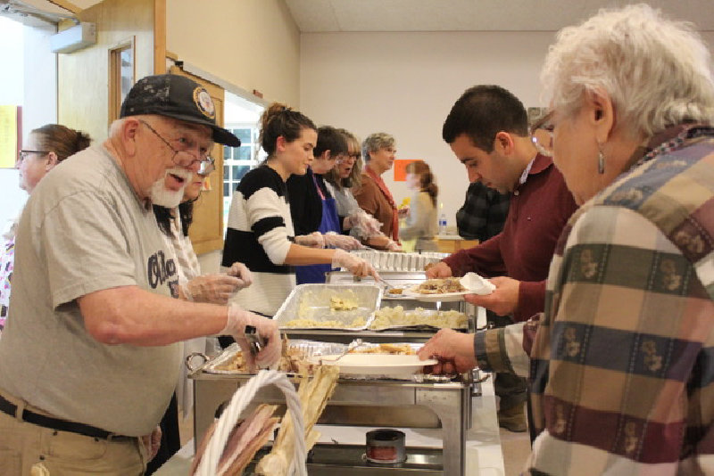 The serving line at Saturday's Thanksgiving meal at Clintondale Christian Church was busy.