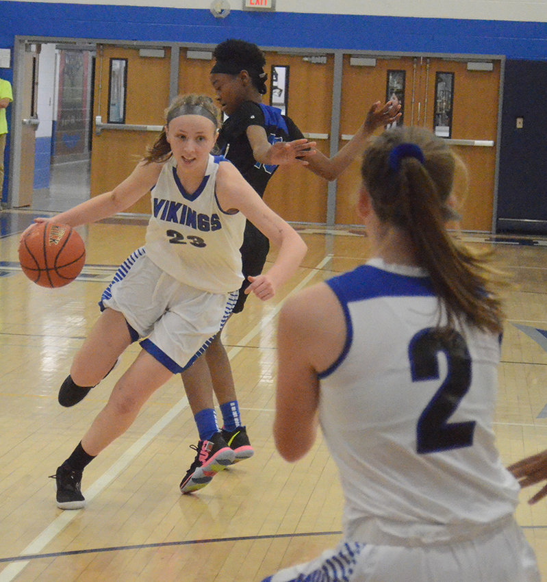 Valley Central's Erin Rose Cooney drives past Middletown's Alyze Skyers as Valley Central's Madline Feller looks for a pass during Saturday's Corinne Feller Memorial Tip-Off Tournament girls' basketball game at Valley Central High School in Montgomery.