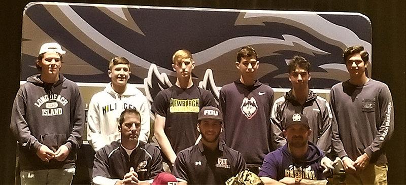 Lucas Prokosch poses with his teammates and coaches.