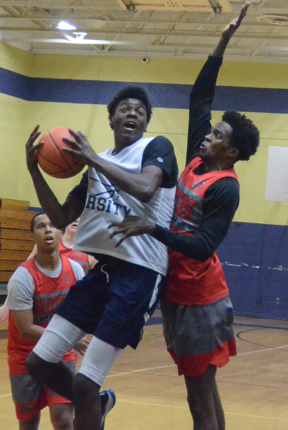 Newburgh's Deondre Johnson goes up for a shot during Thursday's scrimmage against North Rockland.