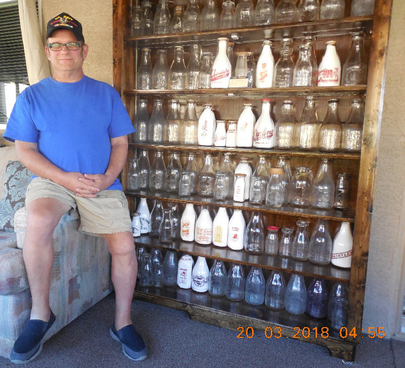 Joe Kirby with some of his vast collection of milk bottles.