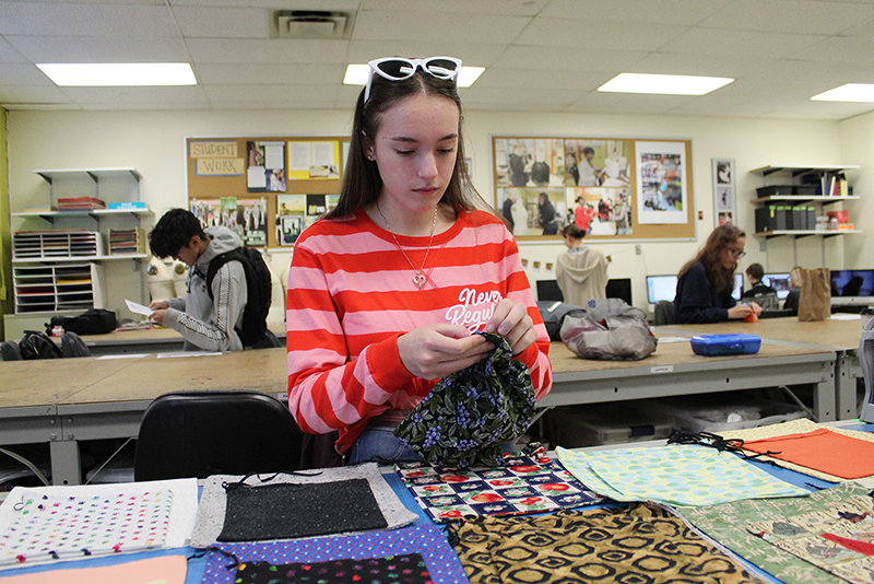Ulster BOCES Fashion Design student Sara Moscatello, from the Highland Central School District, makes a reusable shopping bag that will be included in the donations from the Ulster BOCES annual Thanksgiving Food Drive.