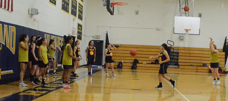 The Highland girls' basketball team practices on Friday at Highland High School.