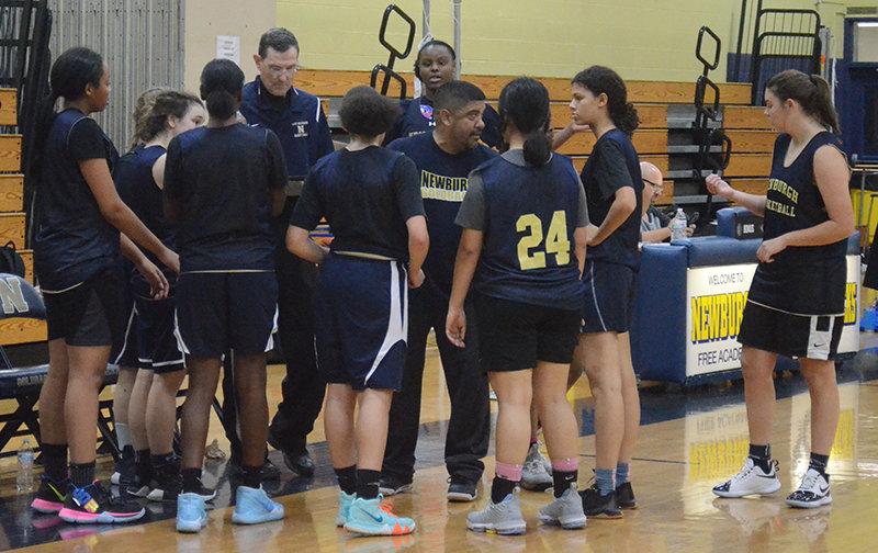 Newburgh coach Arturo Santana talks to his team during last week's scrimmage against Wallkill at Newburgh Free Academy.