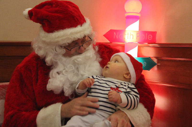 Michael Falkner, 9 months, of Walden, was fascinated by his first encounter with Santa Claus.