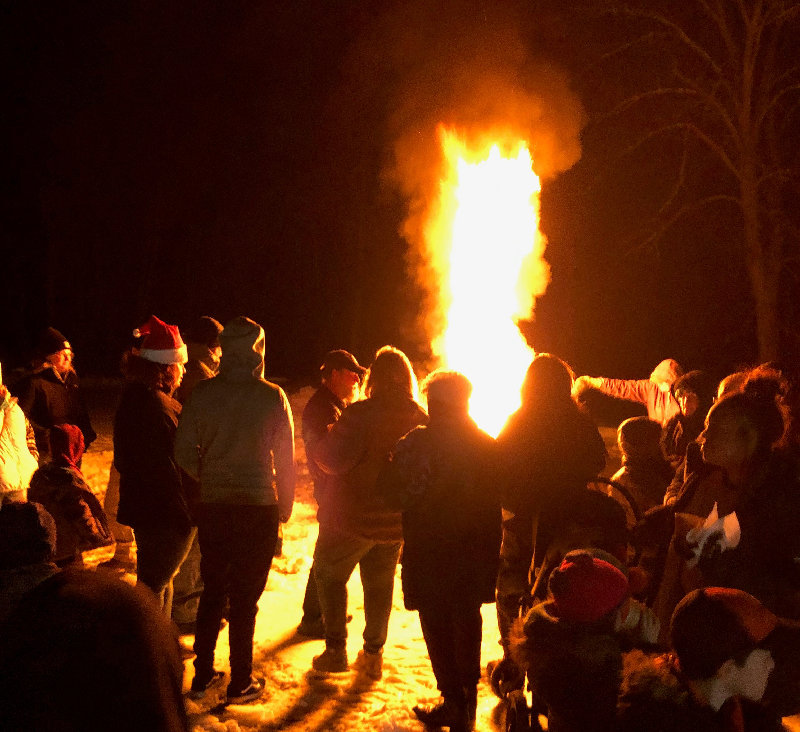 A large bonfire helped fight off the winter cold.