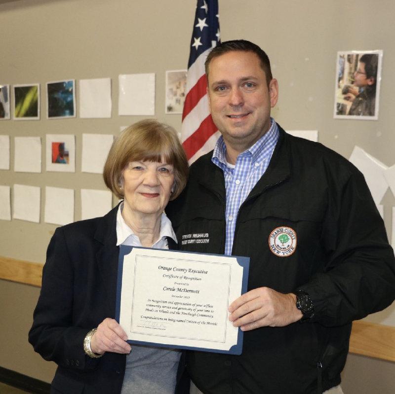 Carole McDermott (left) and Orange County Executive Steven M. Neuhaus.