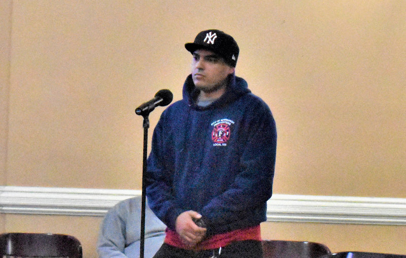 Max Carrero speaks in front of the city council.