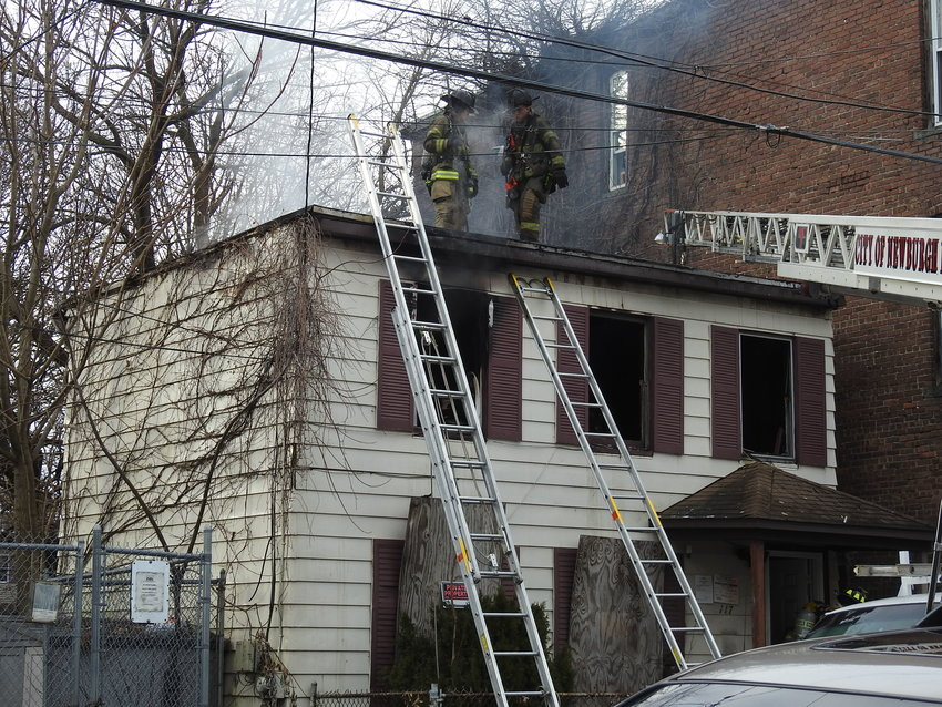 Firefighters at the scene of a New Year's Day fire on West Parmenter Street in the City of Newburgh