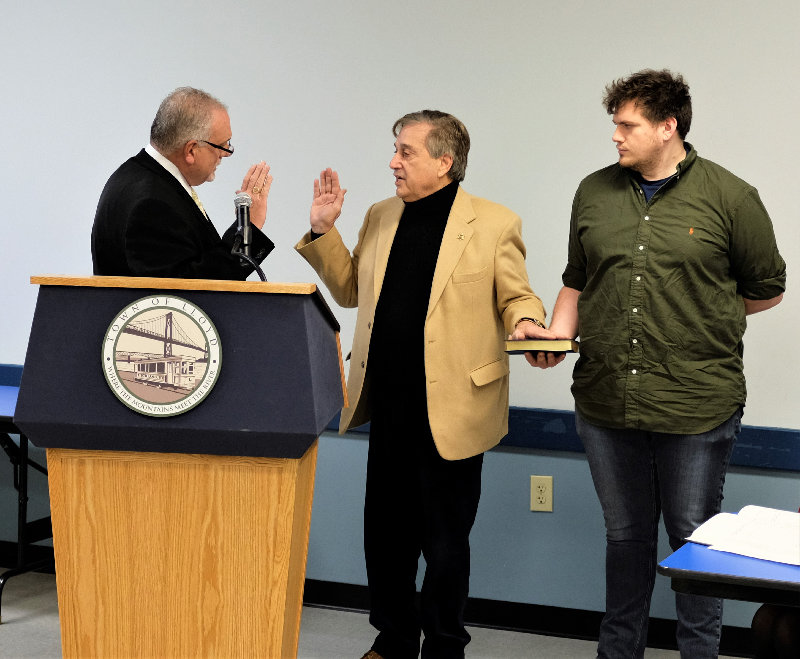 Judge Terry Elia swore in Fred Pizzuto as Lloyd Supervisor, as his son Rick held the family bible.