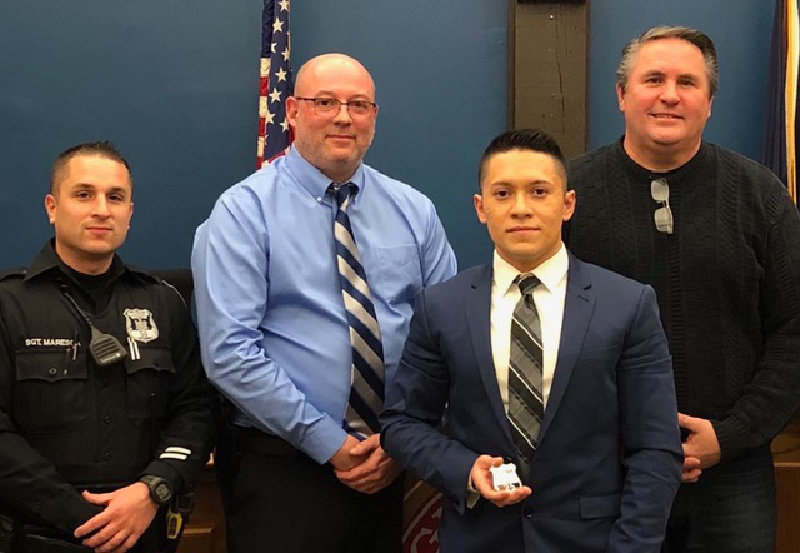 "Maybrook will have a new part-time police officer -- its first bilingual officer -- in March.  Gustavo Pareus (second from right) poses with Maybrook Police Sgt. Michael Maresco, Police Chief Arnold ""Butch"" Amthor and Mayor Dennis Leahy."