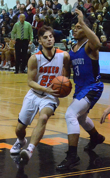 Marlboro's Matt drake drives the lane against Rondout Valley's Marcus Ford during Friday's MHAL boys' basketball game at Marlboro High School.