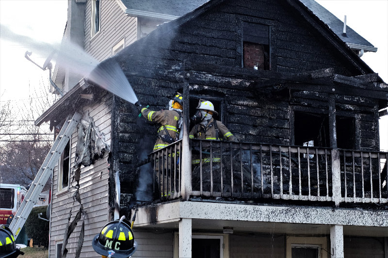 Marlboro firefighters Anthony Biviano (on the hose) is backed up by Cory Rhynehardt, making sure that a house fire is completely out at 37 Grand St last Wednesday afternoon.